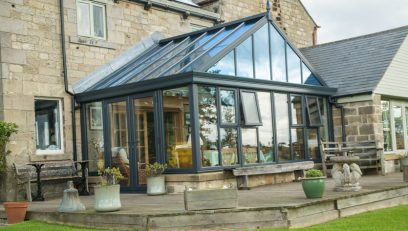 Grey gable conservatory with a glass roof