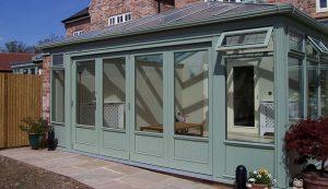 Green timber bifold doors