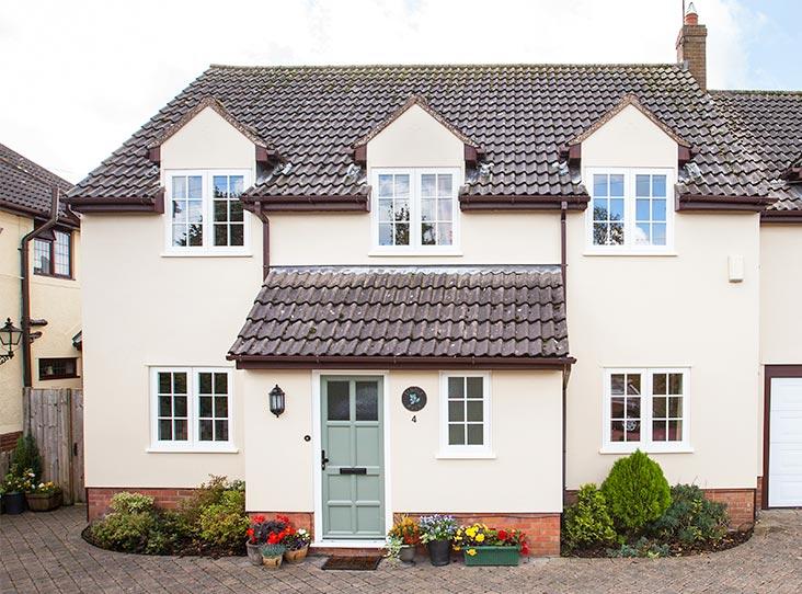heritage casement windows on cream house