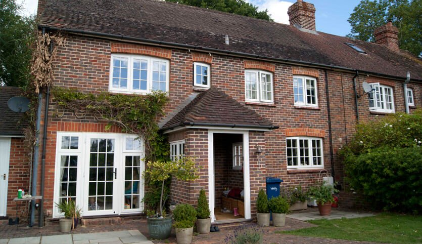 White timber windows on Red brick cottage