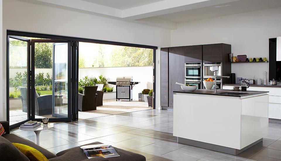 Black bi-fold doors in a modern kitchen